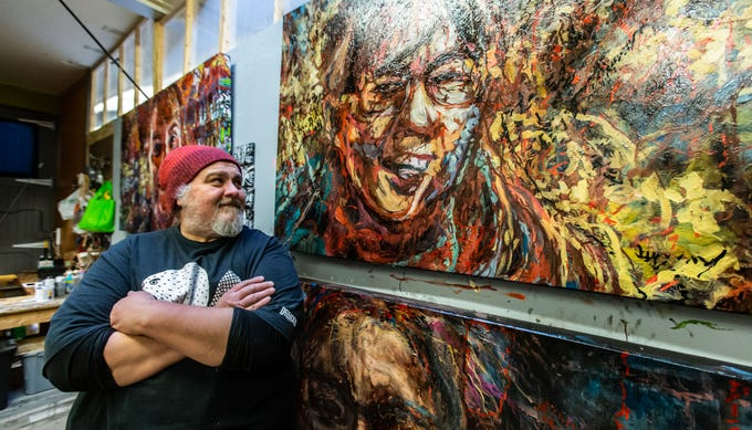 Artist James Barany displays several of his portrait composites inside The Springs: Gallery/Studios during the Downtown Waukesha Art Crawl on Saturday, March 2, 2019.