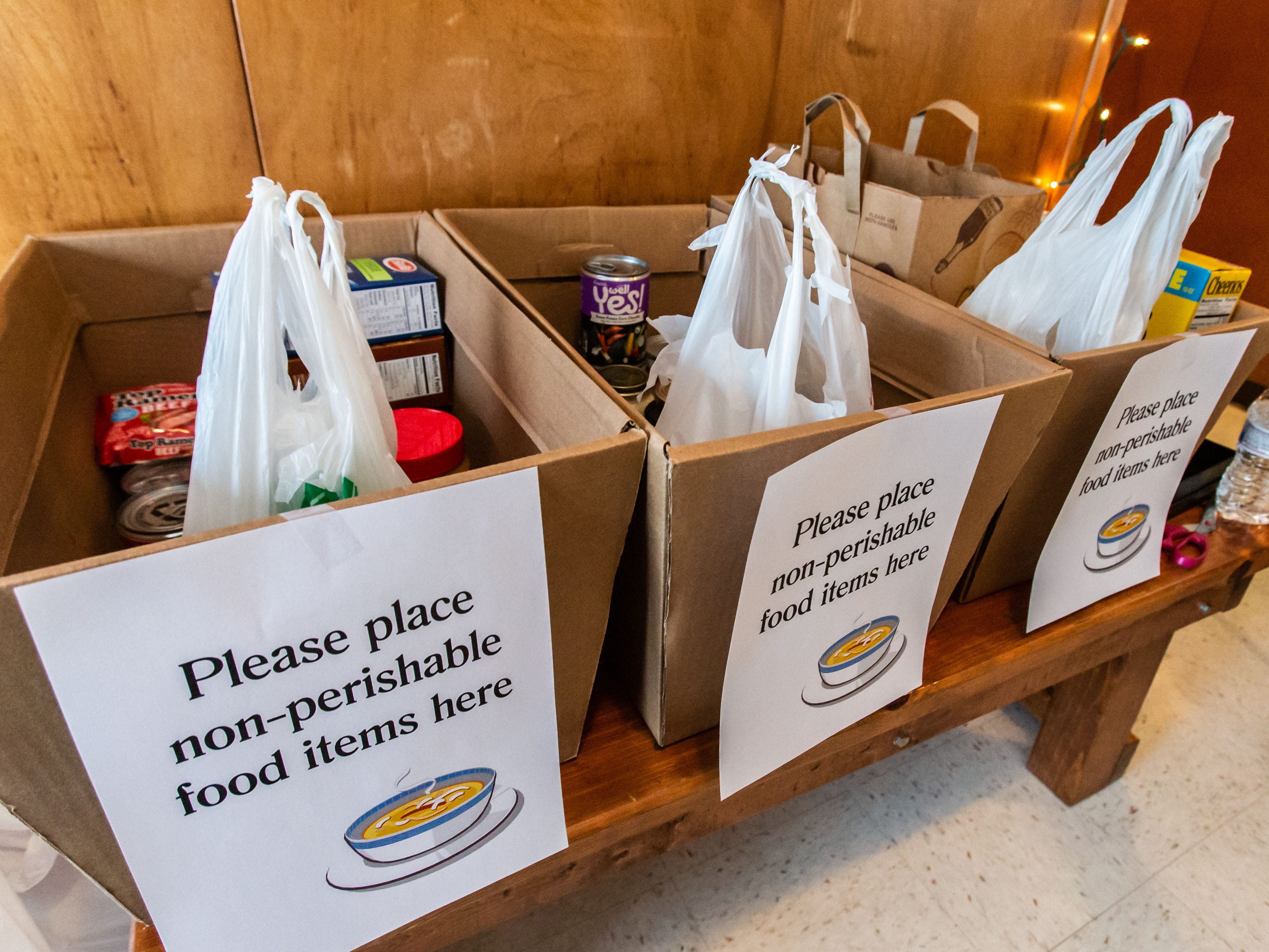 Attendees drop off donations during the 8th annual Empty Bowls event at the LaFollette Park Pavilion in West Allis on Saturday, March 2, 2019. The goal of the event, hosted by the Friends of LaFollette Park, is to collect food and raise funds for West Allis food pantries.