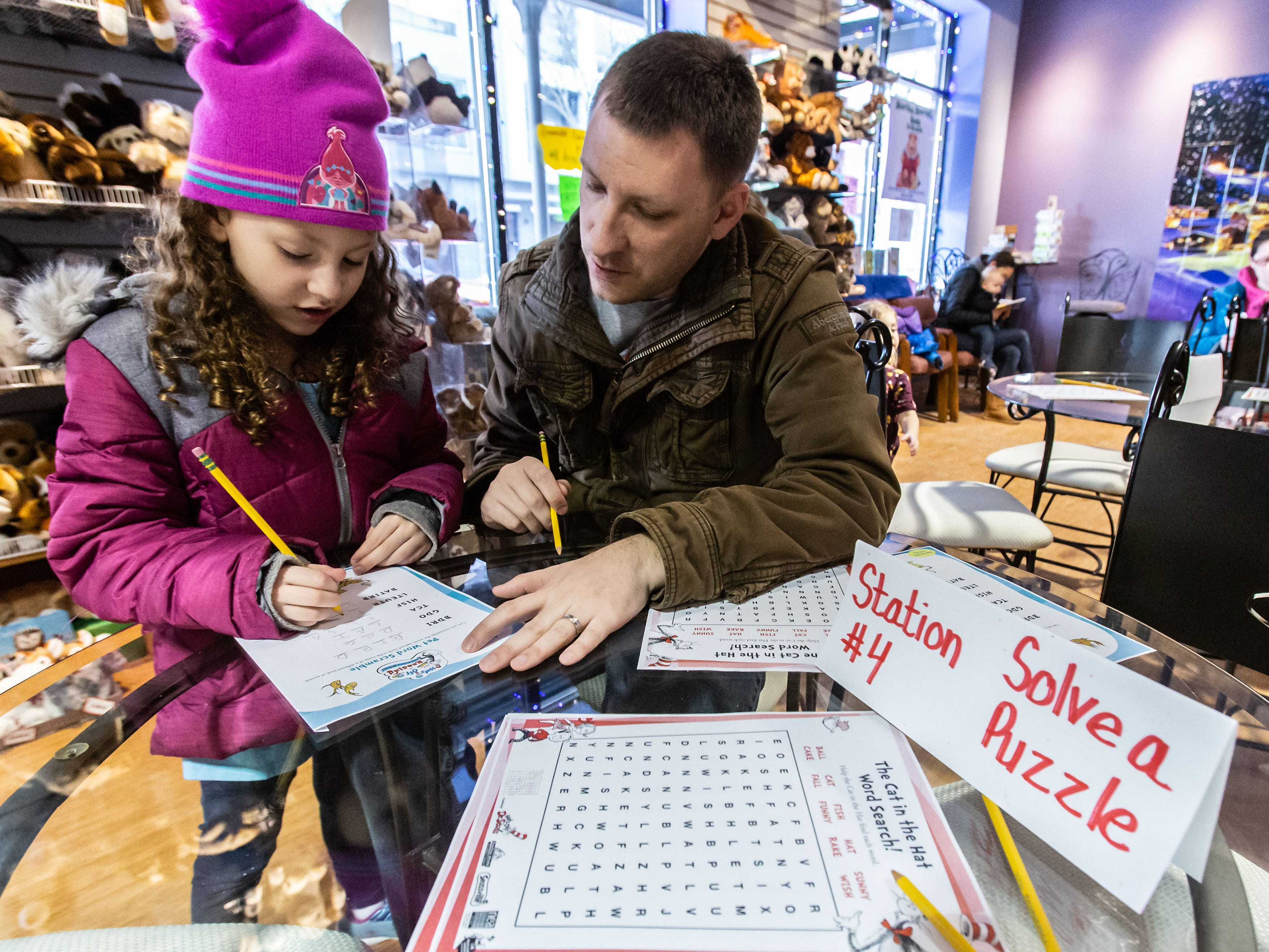 Mike Hillmer and his daughter Evelyn, 6, of Waukesha work on a puzzle at Martha Merrell's Books & Toys during the Birthday Bash Downtown Waukesha Art Crawl on Saturday, March 2, 2019. The event celebrated the birthday of Dr. Seuss with a special birthday party complete with cake, coloring pages and more at Martha Merrell's Books.