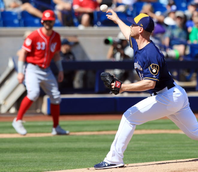 Milwaukee Brewers Josh Tomlin delivers a pitch during the first inning of their spring training game against the Cincinnati Reds, Sunday, March 3, in Phoenix, Arizona.(Photo/Roy Dabner) ORG XMIT: RD118