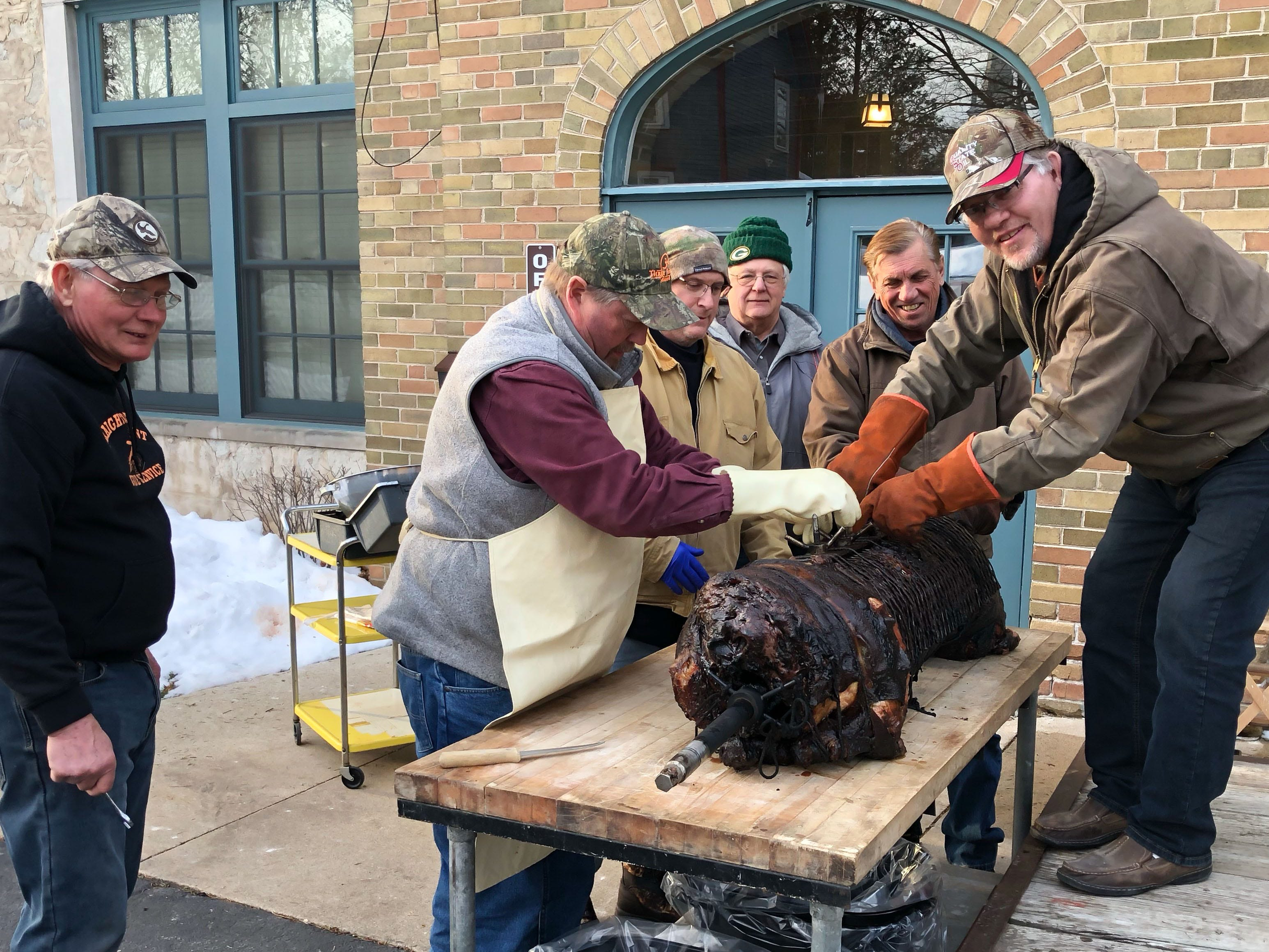 Parishioners prepare to serve up the main course during the Mardi Gras Pig Roast and pie auction at Immanuel Lutheran Church in Cedarburg on Sunday, March 3, 2019. The event is a fundraiser for the church.