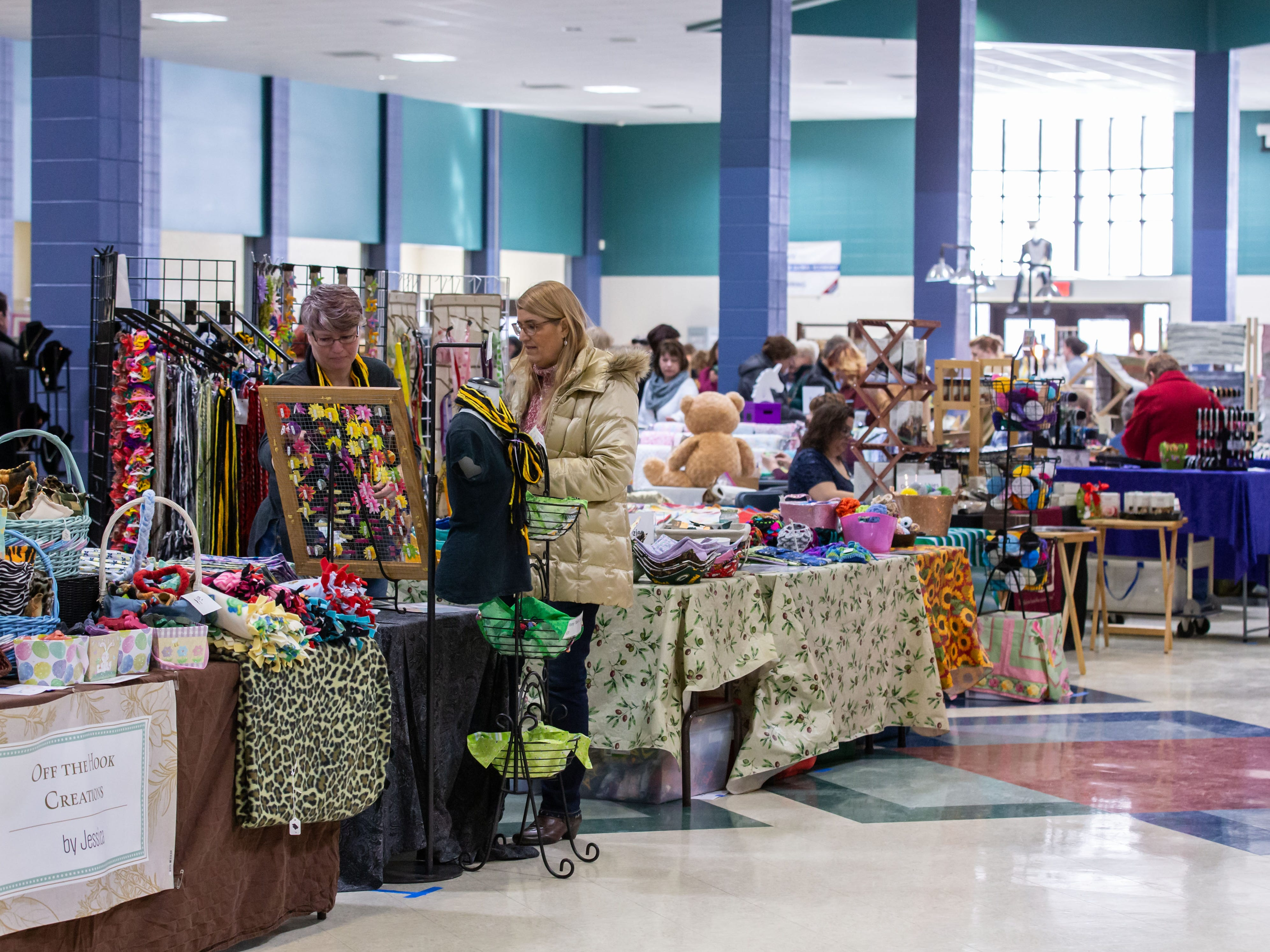 Shoppers browse a selection of unique hand-crafted items from over eighty vendors during the 3rd annual March into Spring Craft Fair at Franklin High School on Saturday, March 2, 2019. The event is a fundraiser for the Franklin High School Marching Band.