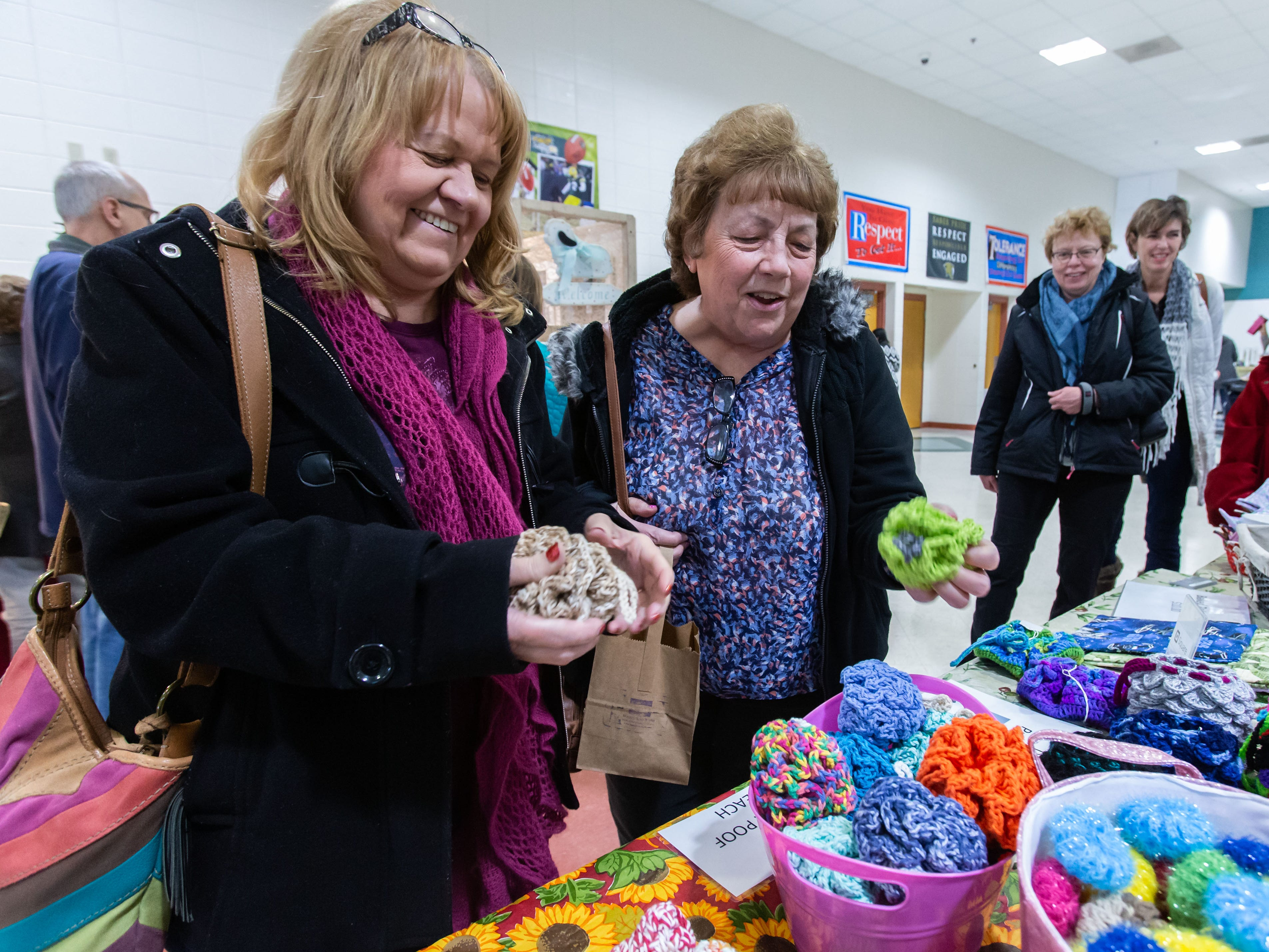 Cheryl Corey (left) of Waterford and Pat Awe of Milwaukee look over a variety of hand-crafted items during the 3rd annual March into Spring Craft Fair at Franklin High School on Saturday, March 2, 2019. The event is a fundraiser for the Franklin High School Marching Band.