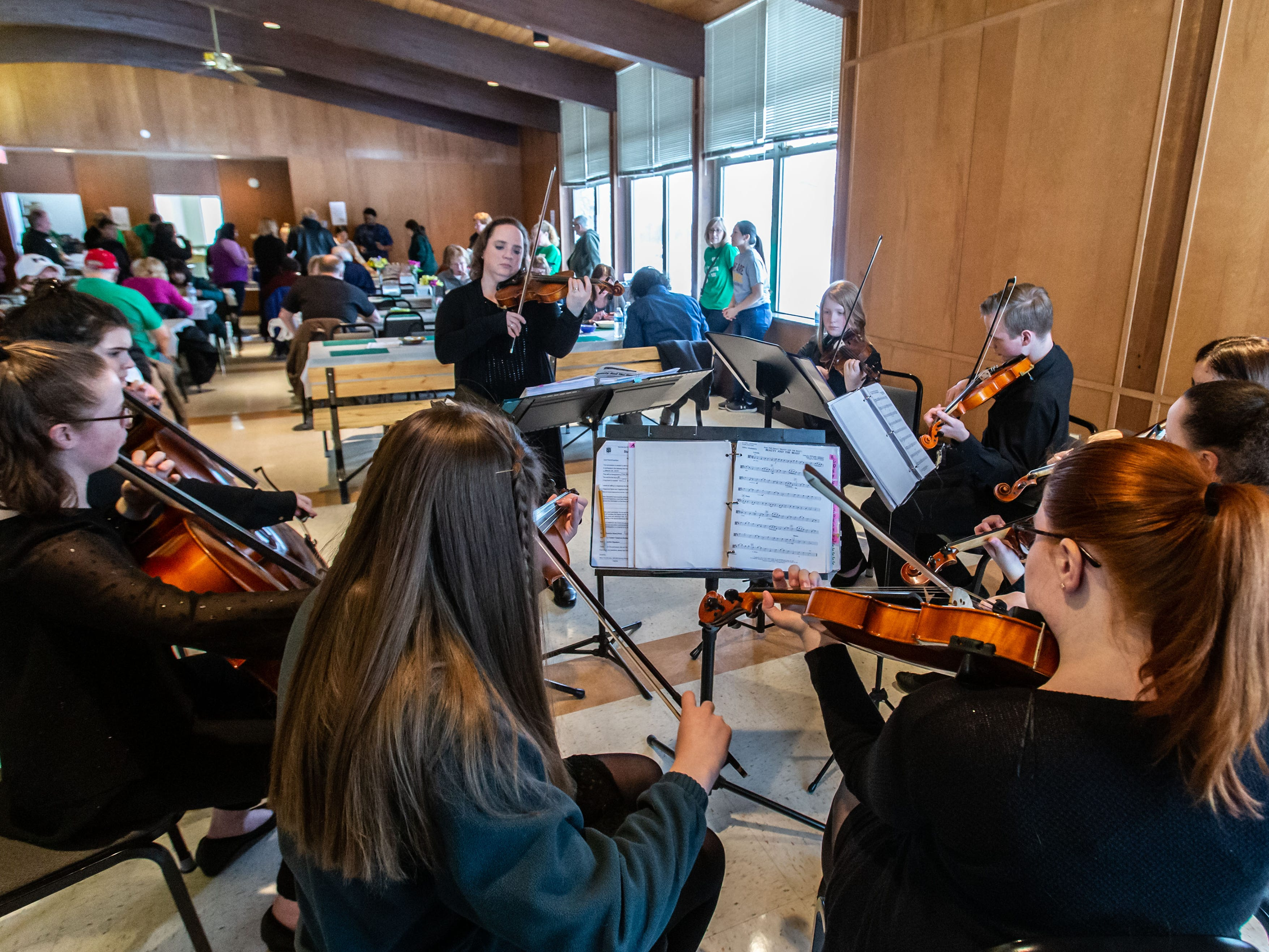 Members of the West Allis-West Milwaukee Shining Strings (string ensemble) perform during the 8th annual Empty Bowls event at the LaFollette Park Pavilion in West Allis on Saturday, March 2, 2019. The goal of the event, hosted by the Friends of LaFollette Park, is to collect food and raise funds for West Allis food pantries.