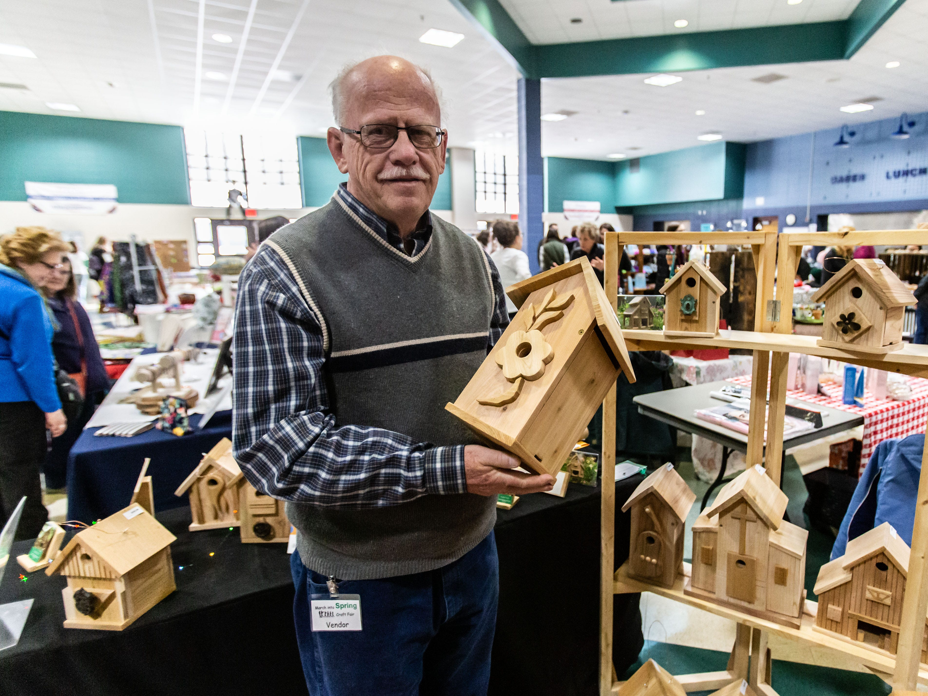 Dennis Otwaska of Racine offers up a variety of hand-made bird houses during the 3rd annual March into Spring Craft Fair at Franklin High School on Saturday, March 2, 2019. The event is a fundraiser for the Franklin High School Marching Band.