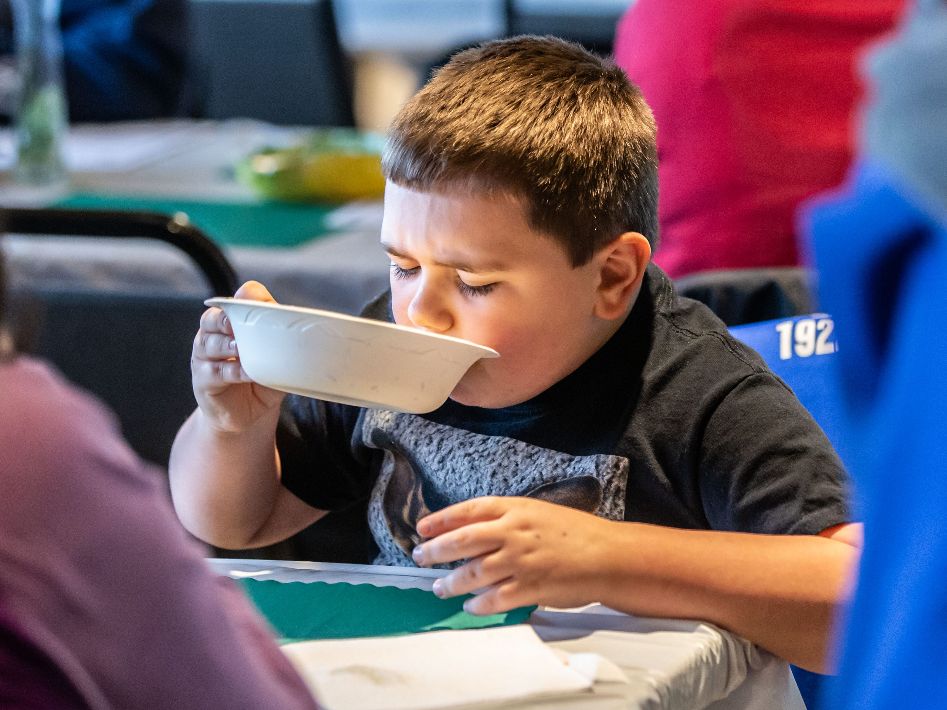 Anthony Pelicaric, 8, of West Allis finishes every last drop of his soup during the 8th annual Empty Bowls event at the LaFollette Park Pavilion in West Allis on Saturday, March 2, 2019. The goal of the event, hosted by the Friends of LaFollette Park, is to collect food and raise funds for West Allis food pantries. Local restaurants, including Senor Sol, Urban Joe Cafe, Filippo's Italian Restaurant, Pallas Restaurant, and West Allis Cheese and Sausage Shop donate the delicious soups offered at the event.
