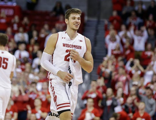 Wisconsin's Ethan Happ (22) walks back to the bench after making two free throws, giving Happ a triple-double, during the second half of the team's NCAA college basketball game against Coppin State on Tuesday, Nov. 6, 2018, in Madison, Wis. Wisconsin won 85-63. (AP Photo/Andy Manis) ORG XMIT: WIAM108