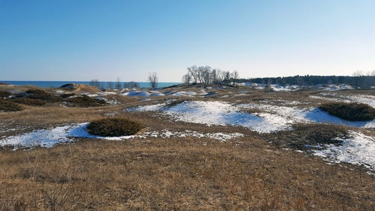 Patches of snow dot the dunes along Lake Michigan at Kohler-Andrae State Park in Sheboygan on March 10, 2018.