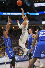 Marquette's Markus Howard finds an opening for a shot against Creighton. Howard finished with 33 points and was the only MU player to score in double figures.