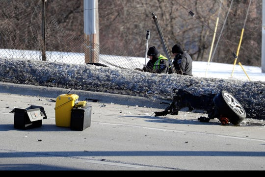 Milwaukee County sheriff's deputies work at the scene of a fatal crash Monday afternoon along eastbound I-94 near 38th Street. The eastbound lanes of the busy interstate were closed at the Stadium Interchange because of the crash. The Wisconsin Department of Transportation was urging motorists to take alternate routes.