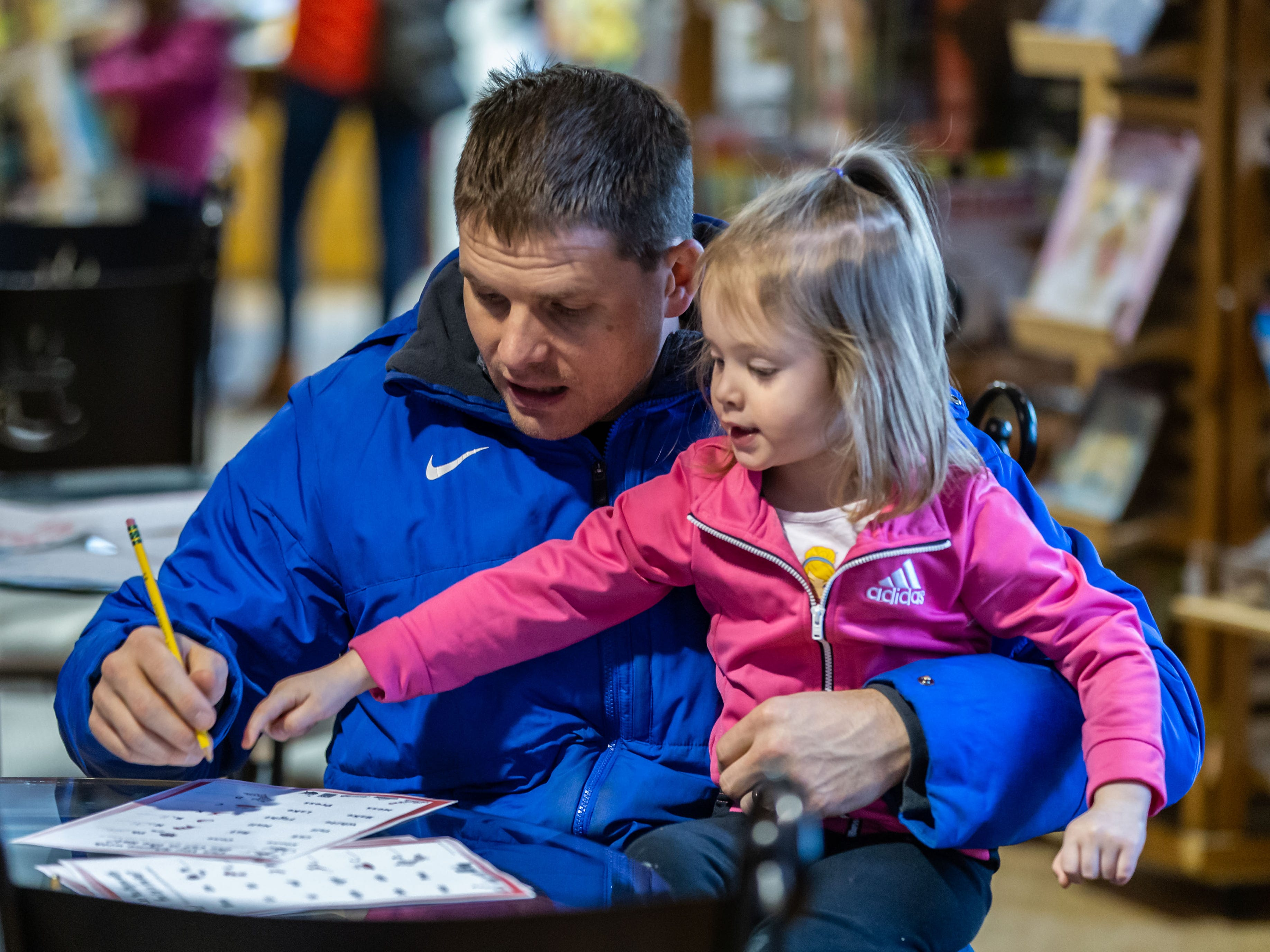 Patrick Detmer and his daughter Hailey, 3, of Waukesha play a game at Martha Merrell's Books & Toys during the Birthday Bash Downtown Waukesha Art Crawl on Saturday, March 2, 2019. The event celebrated the birthday of Dr. Seuss with a special birthday party complete with cake, coloring pages and more at Martha Merrell's Books.