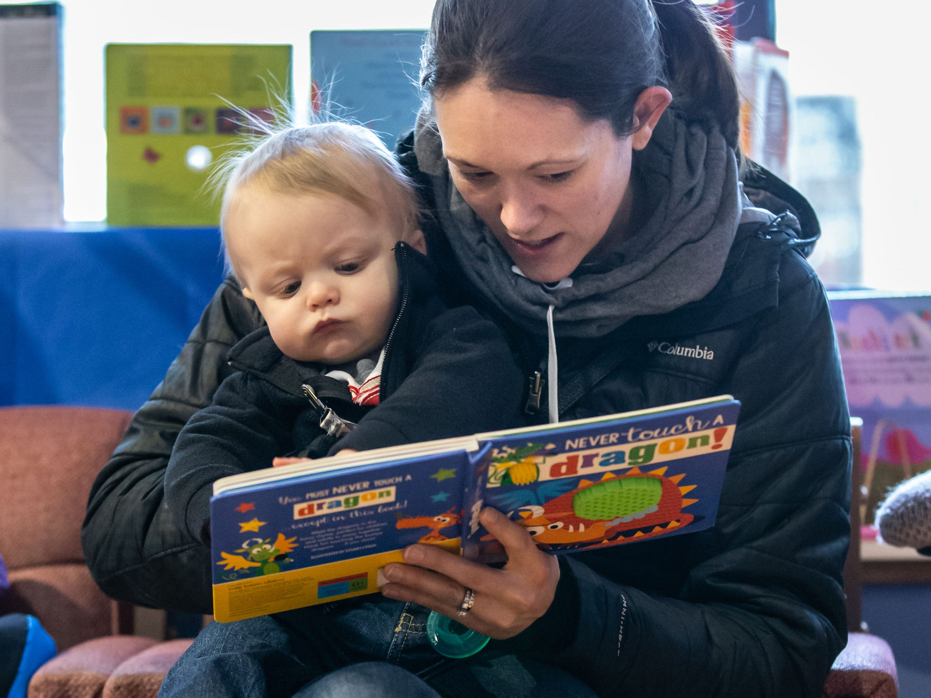 Sarah Detmer of Waukesha reads to her ten-month-old son Kellen at Martha Merrell's Books & Toys during the Birthday Bash Downtown Waukesha Art Crawl on Saturday, March 2, 2019. The event celebrated the birthday of Dr Seuss with a special birthday party complete with cake, coloring pages and more at Martha Merrell's Books.