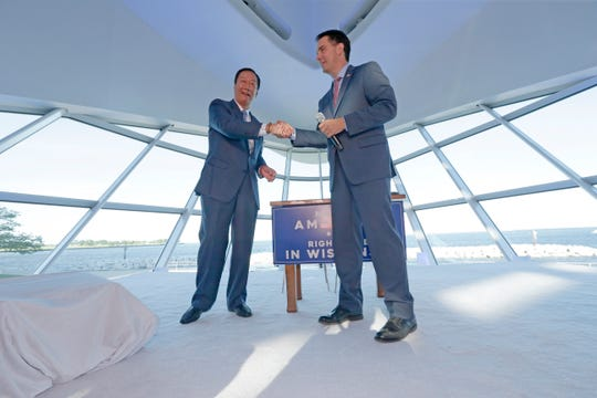 Foxconn Chairman Terry Gou (left) and Gov. Scott Walker shake hands during a July 27, 2017, ceremony at the Milwaukee Art Museum, where they signed a memorandum of understanding outlining Foxconn's agreement with Wisconsin.