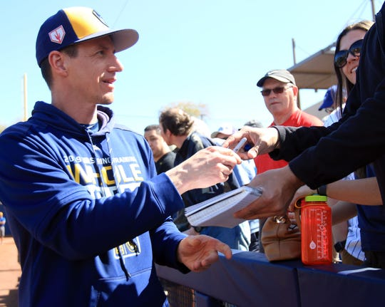 Milwaukee Brewers Manager Craig Counsell signs autographs prior to their spring training game against the San Diego Padres at American Family Fields of Phoenix, Tuesday, February 26, in Phoenix, Arizona.(Photo/Roy Dabner) ORG XMIT: RD084