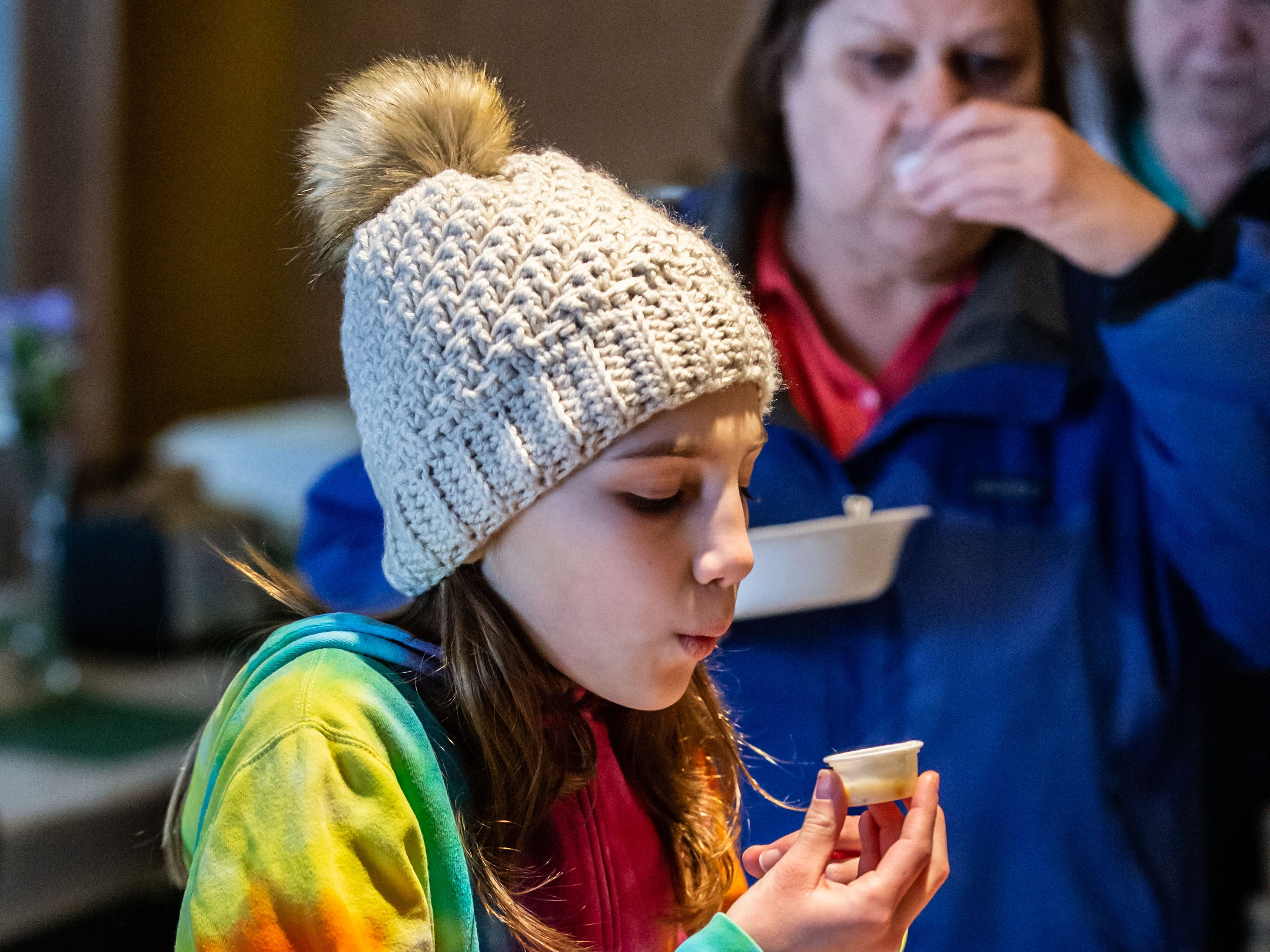 Elena May, 11, of West Allis tries a free sample of soup during the 8th annual Empty Bowls event at the LaFollette Park Pavilion in West Allis on Saturday, March 2, 2019. The goal of the event, hosted by the Friends of LaFollette Park, is to collect food and raise funds for West Allis food pantries. Local restaurants, including Senor Sol, Urban Joe Cafe, Filippo's Italian Restaurant, Pallas Restaurant, and West Allis Cheese and Sausage Shop donate the delicious soups offered at the event.