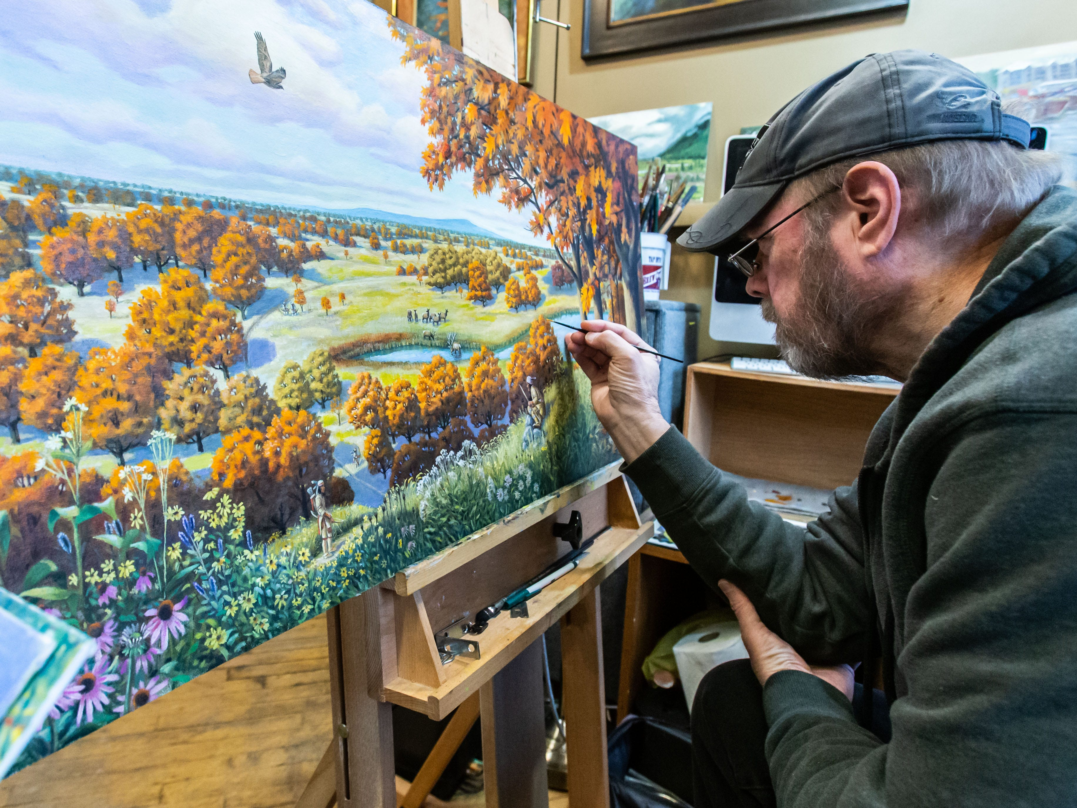 Artist Thomas Buchs works on a painting at The Springs: Gallery/Studios in Waukesha during the Downtown Waukesha Art Crawl on Saturday, March 2, 2019.