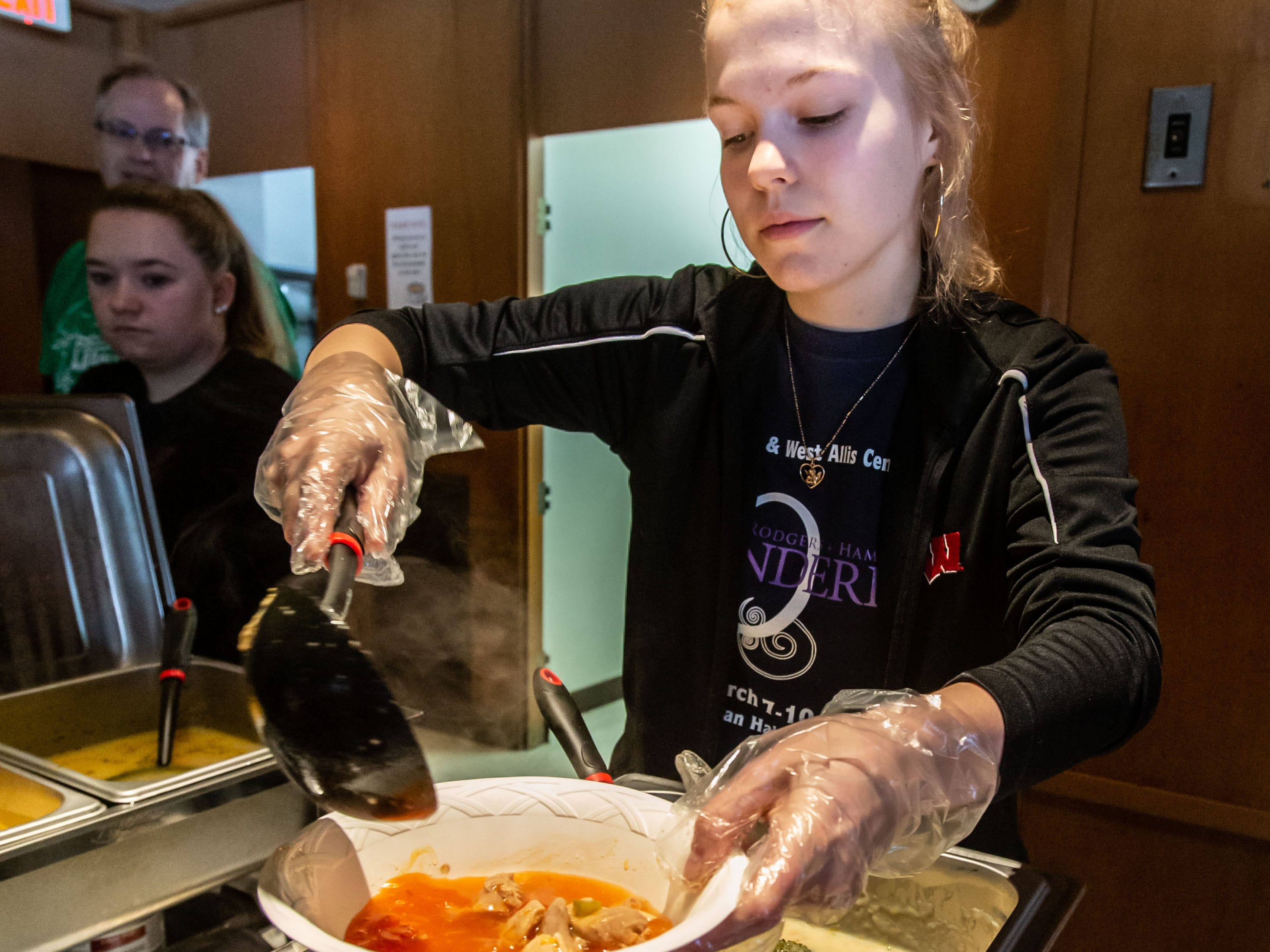 Volunteer Abigail Houck of West Allis fills a bowl of soup during the 8th annual Empty Bowls event at the LaFollette Park Pavilion in West Allis on Saturday, March 2, 2019. The goal of the event, hosted by the Friends of LaFollette Park, is to collect food and raise funds for West Allis food pantries. Local restaurants, including Senor Sol, Urban Joe Cafe, Filippo's Italian Restaurant, Pallas Restaurant, and West Allis Cheese and Sausage Shop donate the delicious soups offered at the event.