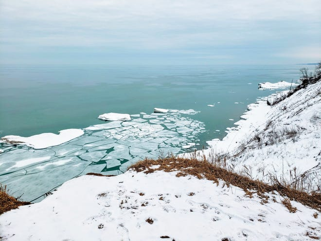 Pancake ice floats on Lake Michigan below the bluffs at Lion's Den Gorge Nature Preserve in Ozaukee County on March 1, 2019.