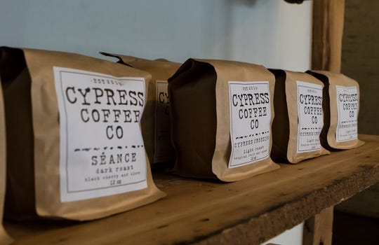 Bag of take home blends line a shelf at the newly opened Cypress Coffee Co. in downtown Monroe, La. on March 3. The shop occupies the space left by RoeLa Roasters and had its first day of business on Monday.
