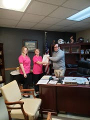 West Carroll Parish Registrar of Voters Kellie Drurey and Assistant Registrar Stephanie Boyte serve Oak Grove Mayor Adam Holland a petition signed by 347 qualified electors of the town of Oak Grove calling for an election to determine the sale and consumption of alcoholic beverages inside the city limits of Oak Grove.