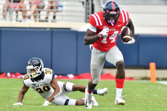 Sep 22, 2018; Oxford, MS, USA; Mississippi Rebels wide receiver D.K. Metcalf (14) runs the ball against the Kent State Golden Flashes during the third quarter at Vaught-Hemingway Stadium. Mandatory Credit: Matt Bush-USA TODAY Sports