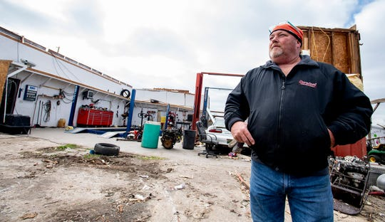 Troy Bell stands by his Bell Automotive and Tire business near Beauregard, Ala., on Monday March 4, 2019. The business lost its roof during the fatal Tornado stuck on Sunday afternoon.