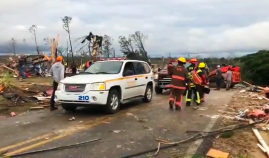 Emergency responders work in the scene amid debris in Lee County, Ala., after what appeared to be a tornado struck in the area Sunday, March 3, 2019. Severe storms destroyed mobile homes, snapped trees and left a trail of destruction amid weather warnings extending into Georgia, Florida and South Carolina, authorities said. (WKRG-TV via AP)