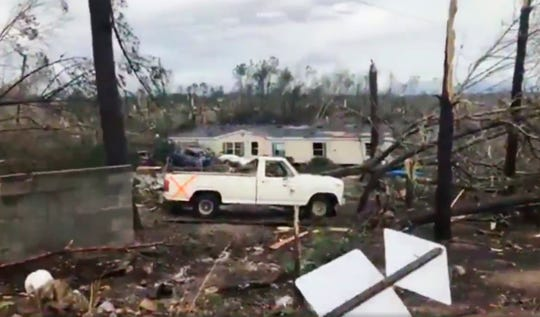 This photo shows debris in Lee County, Ala., after what appeared to be a tornado struck in the area Sunday, March 3, 2019. Severe storms destroyed mobile homes, snapped trees and left a trail of destruction amid weather warnings extending into Georgia, Florida and South Carolina, authorities said. (WKRG-TV via AP)