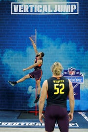Mar 3, 2019; Indianapolis, IN, USA; Mississippi State defensive lineman Montez Sweat (left) do the vertical jump as Michigan defensive lineman Chase Winovich (DL52) looks on during the 2019 NFL Combine at Lucas Oil Stadium. Mandatory Credit: Brian Spurlock-USA TODAY Sports