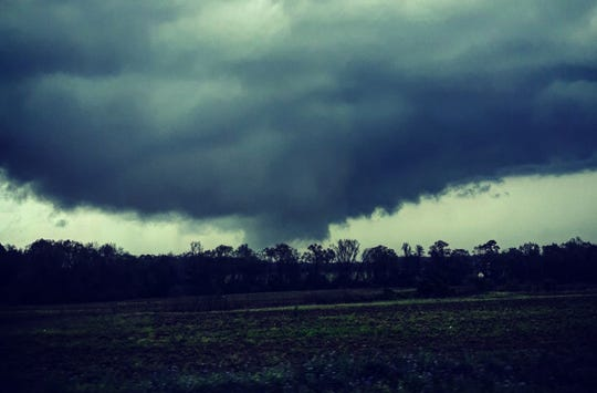 """A tornado killed at least 23 people and caused """"catastrophic"""" damage Sunday."""
