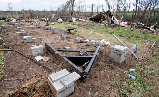 The mobile home of Hunter and Emily Lashley, shown on Monday March 4, 2019, after it was lifted from its location in the foreground and wrapped around the tree in the background by Sunday's tornado near Beauregard, Ala.