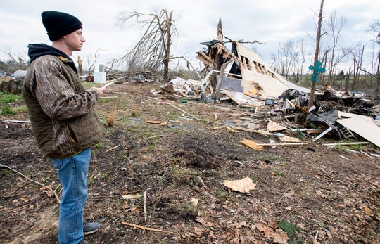Hunter Lashley serches through the debris that was his home near Beauregard, Ala., on Monday March 4, 2019. The mobile home was destroyed by the fatal tornado on Sunday afternoon.