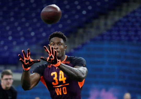 Mar 2, 2019; Indianapolis, IN, USA; Mississippi wide receiver D K Metcalf (WO34) goes through pass catching drills during the workouts during the 2019 NFL Combine at Lucas Oil Stadium. Mandatory Credit: Brian Spurlock-USA TODAY Sports