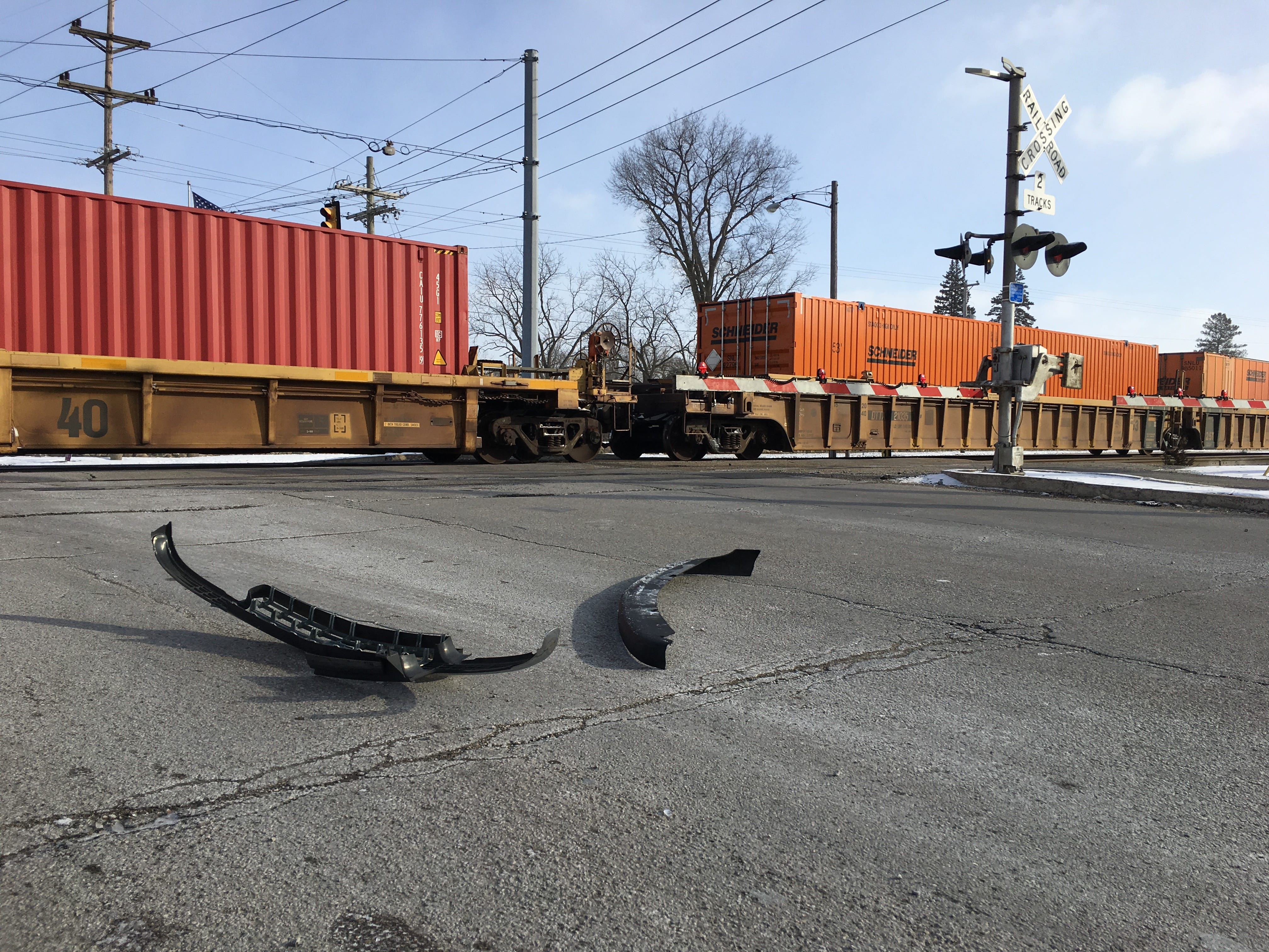 Crash debris is seen at Batavia-Kilgore, the scene of a fatal train-vehicle crash Monday morning. The train pushed the vehicle down the tracks, west of this location.