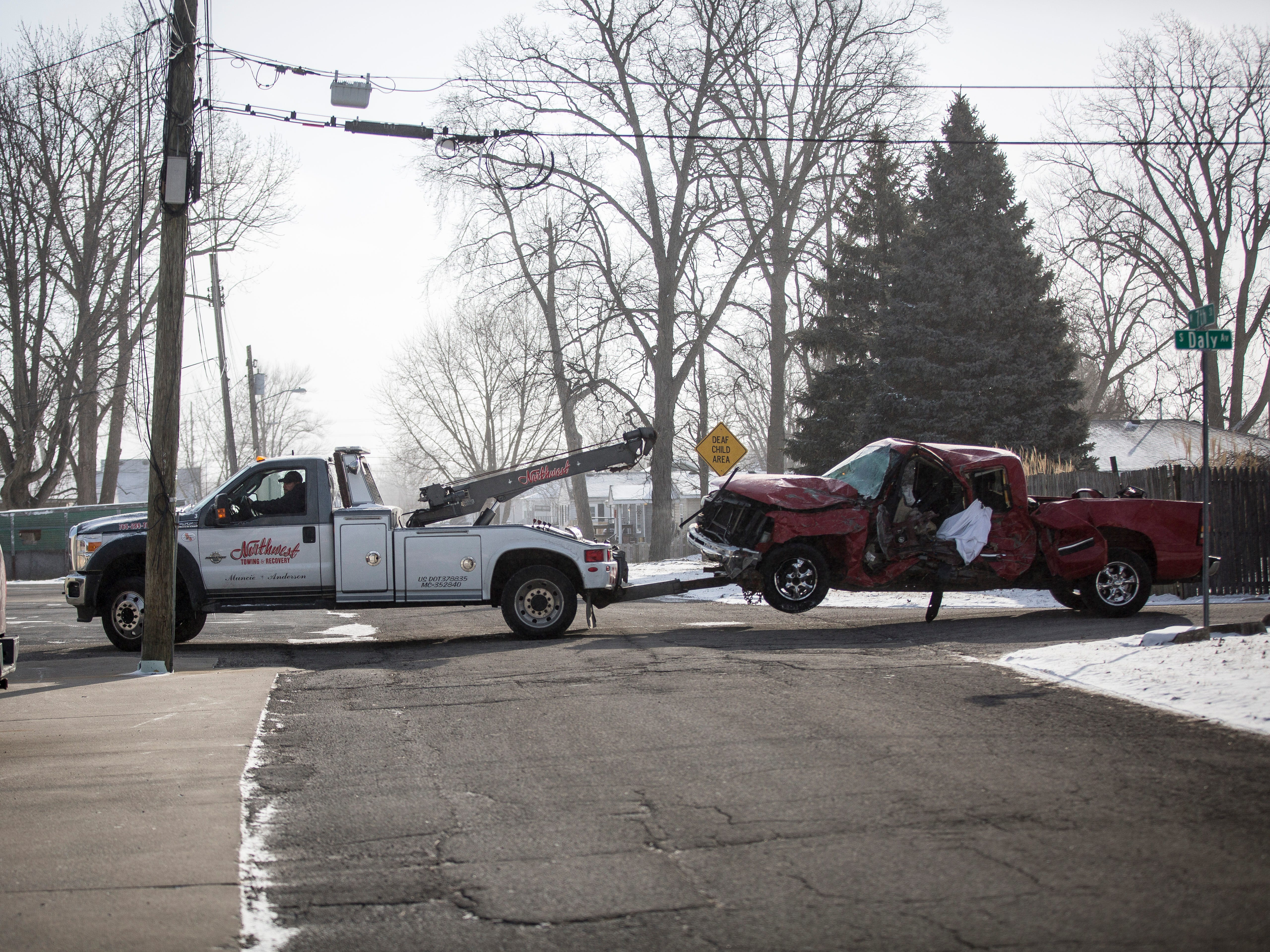 A truck crushed by a train is towed away from the scene of a fatal accident near Batavia and Kilgore avenues. Delaware County Coroner Rick Howell identified the victim as 34-year-old Graham S. Highley of Yorktown.