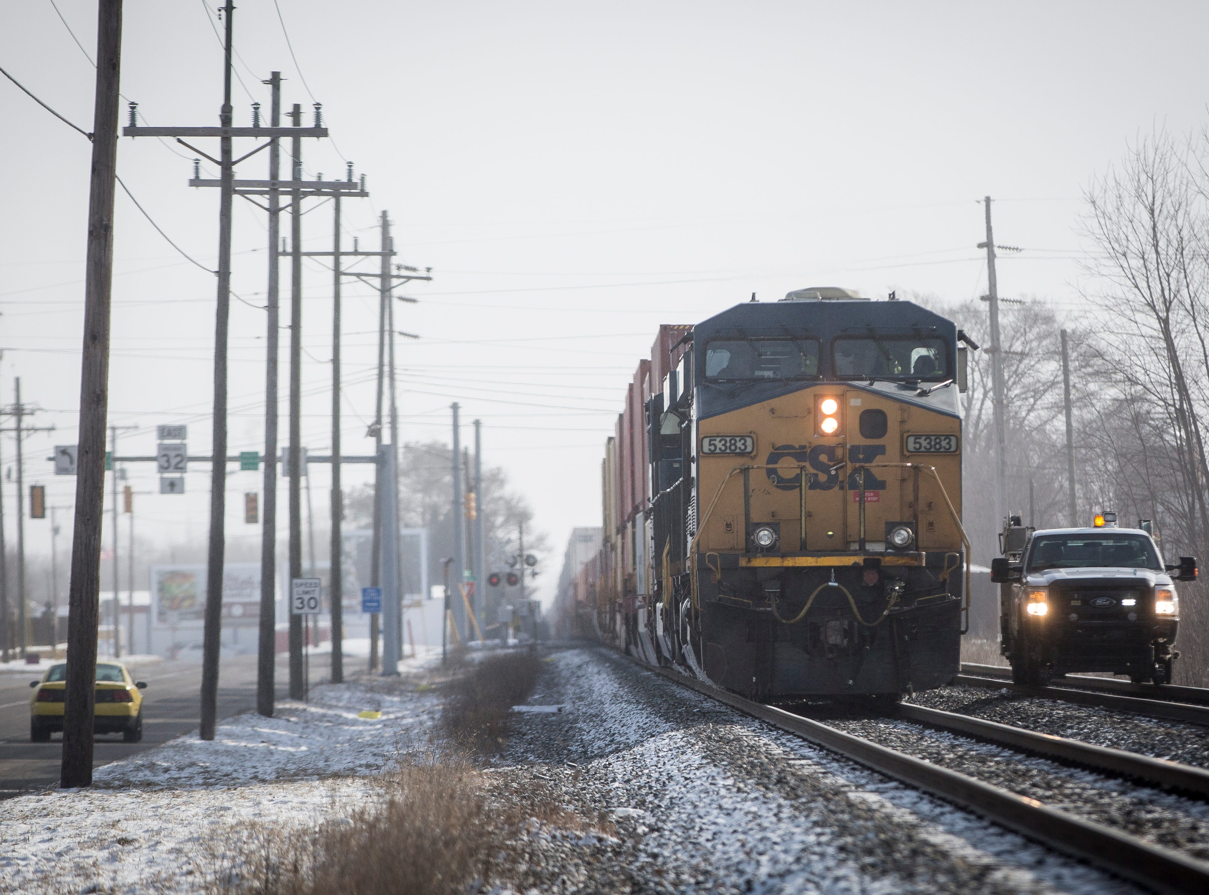 A train remains stopped on the tracks after a man was killed Monday morning when his pickup truck was struck crossing Batavia and Kilgore avenues.