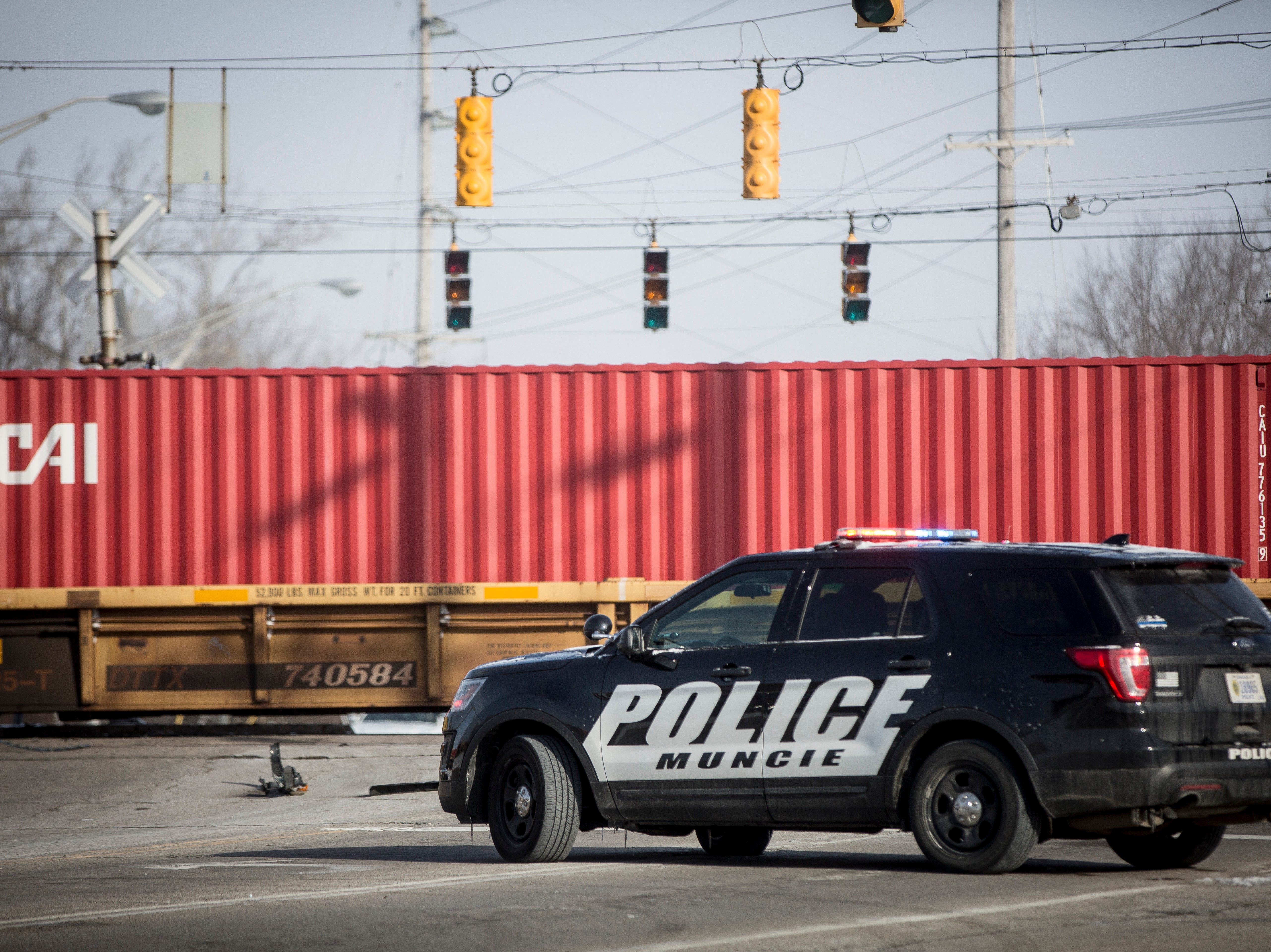 Police block intersections near a stopped train after a man was killed Monday morning when his pickup truck was struck crossing Batavia and Kilgore avenues.