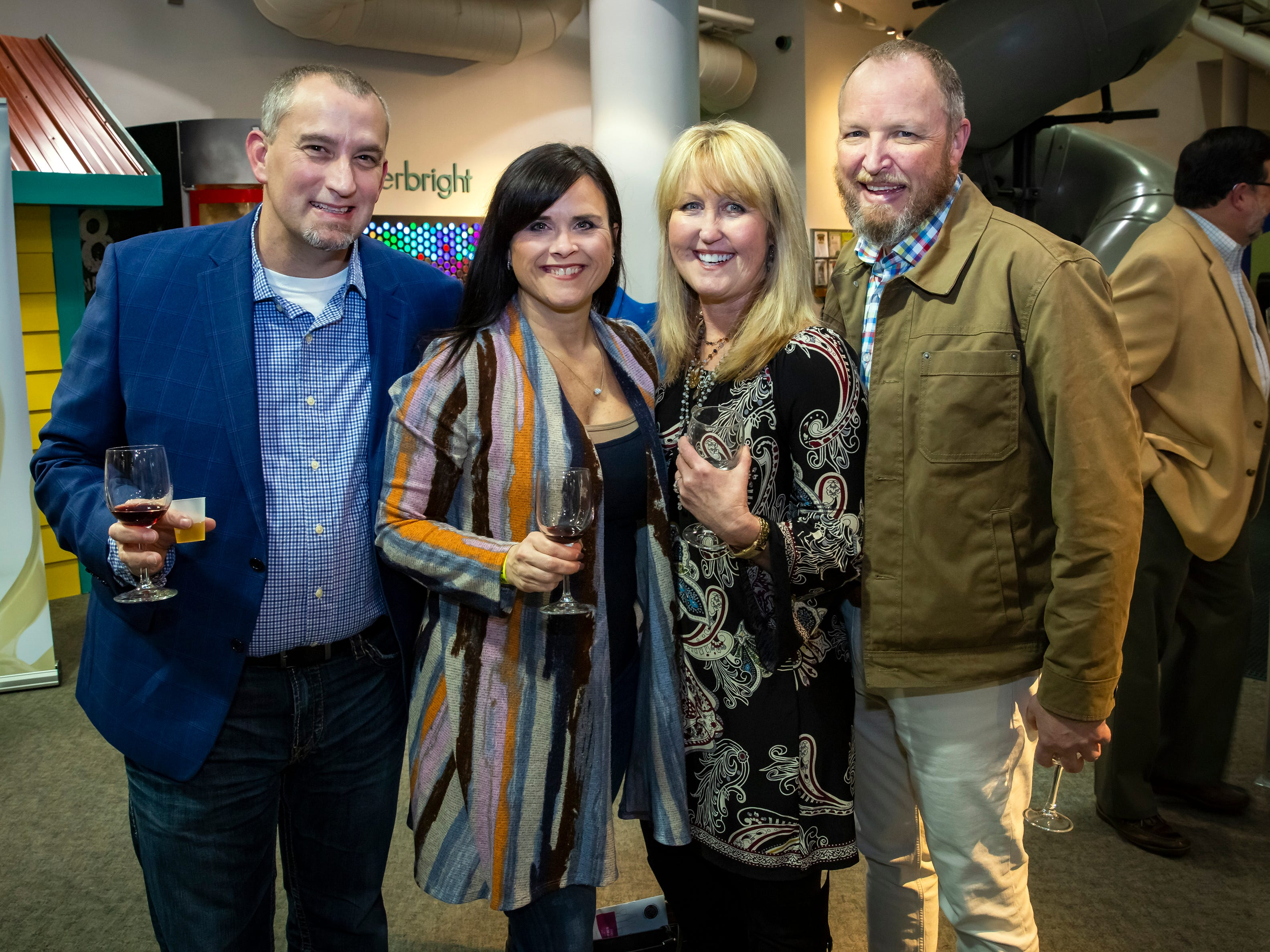Rob and Angela Lyles along with Karen McMahon and Glen Linthicum at the 6th annual Wine and Whiskey at the Wetlands event held at the Discovery Center.