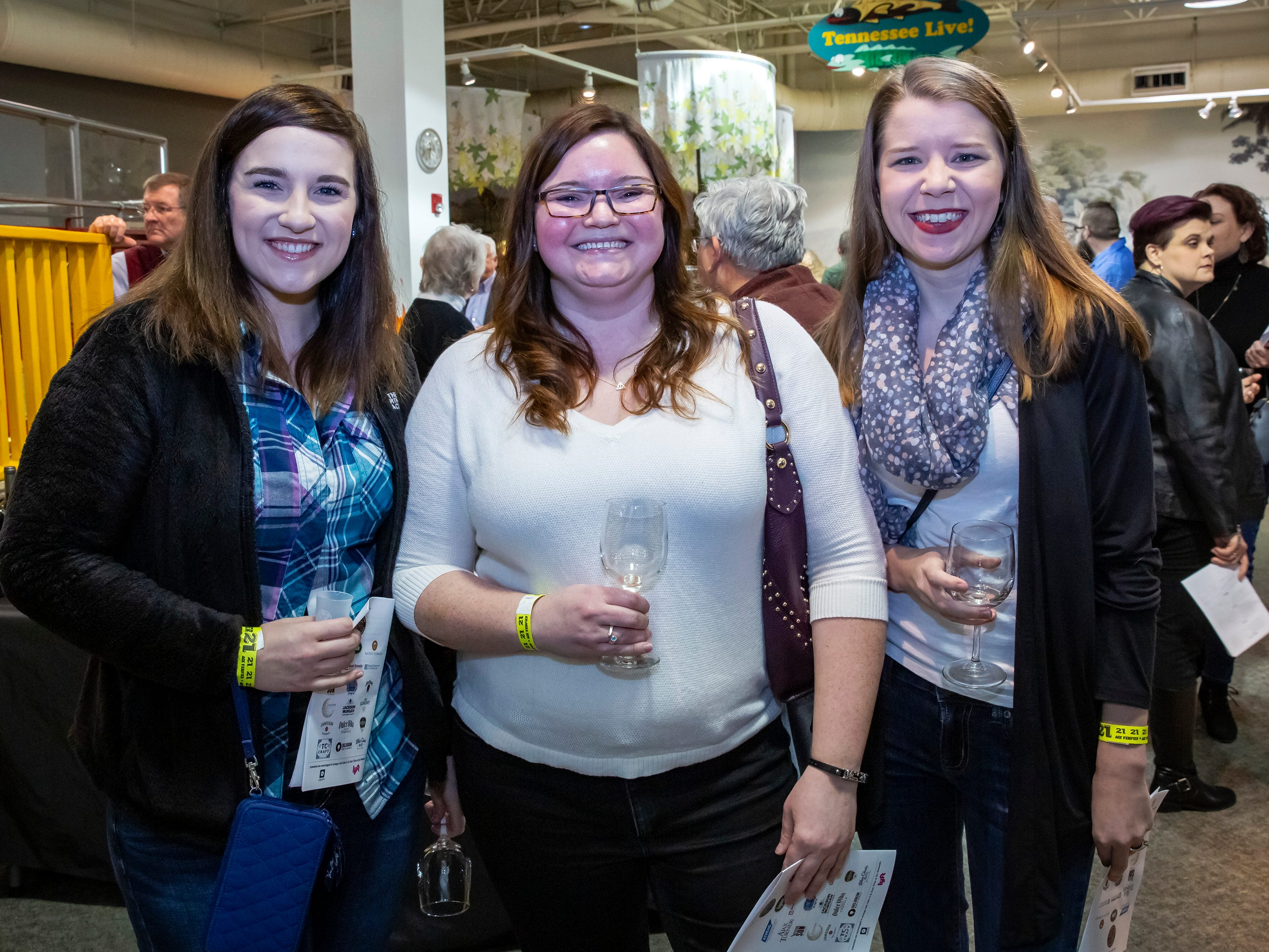 Emily Elliott, Chelsey Cornett and Mellissa Barlar at the 6th annual Wine and Whiskey at the Wetlands event held at the Discovery Center.