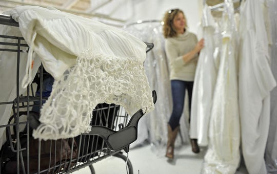 Erron Nunley, of Murfreesboro, looks at wedding dresses during Goodwill's annual sale. This year's sale is March 23 at the Rivergate Goodwill store.