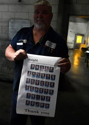Pressmen Ed Frommel holds a page of the paper that honors him and other pressmen for their service at 1100 Broadway Sunday, March 3, 2019, in Nashville, Tenn.  Production resumes Monday night at the Tennessean's sister paper in Knoxville.