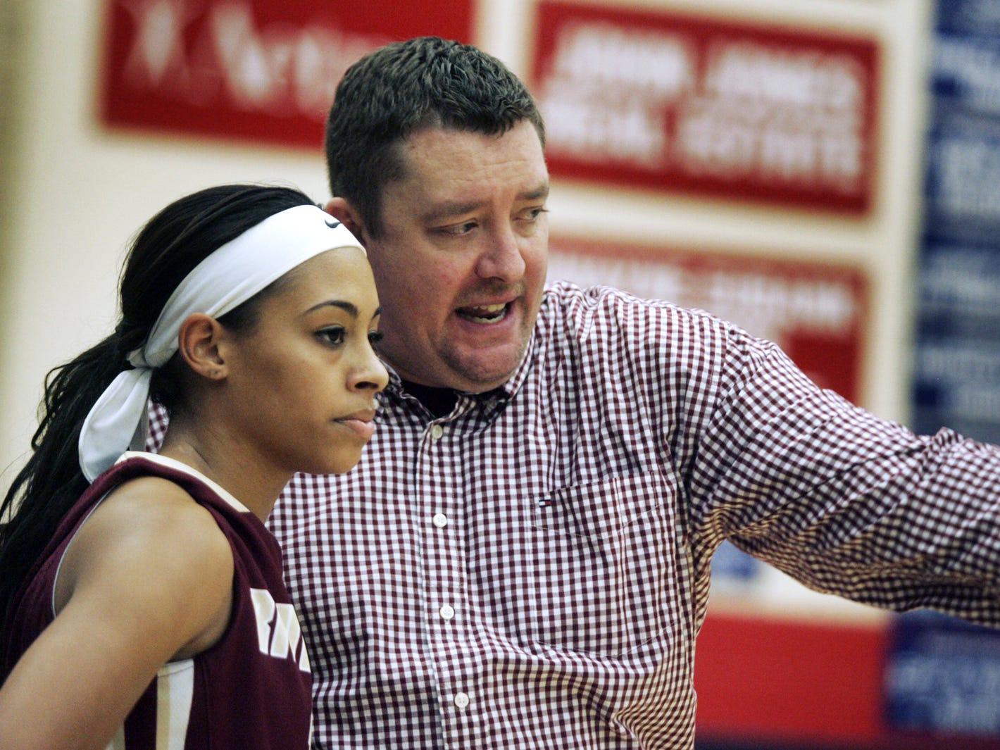 Then-Riverdale girls head coach Cory Barrett with talks with player Tiffany Lewis during game against Oakland, Jan. 4, 2013.