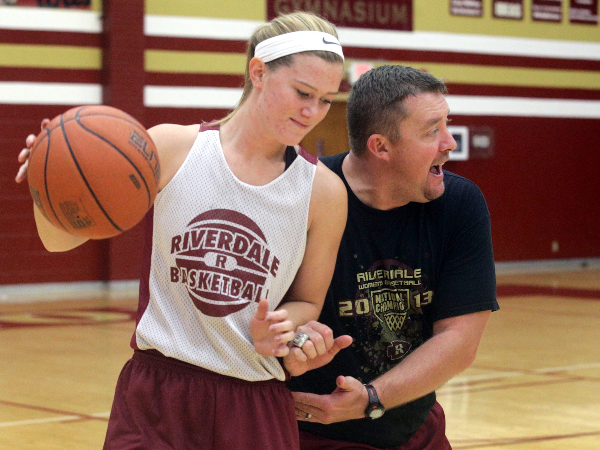 Former Riverdale standout Alexa Middleton works on a drill with then-Riverdale head coach Cory Barrett in October 2013.