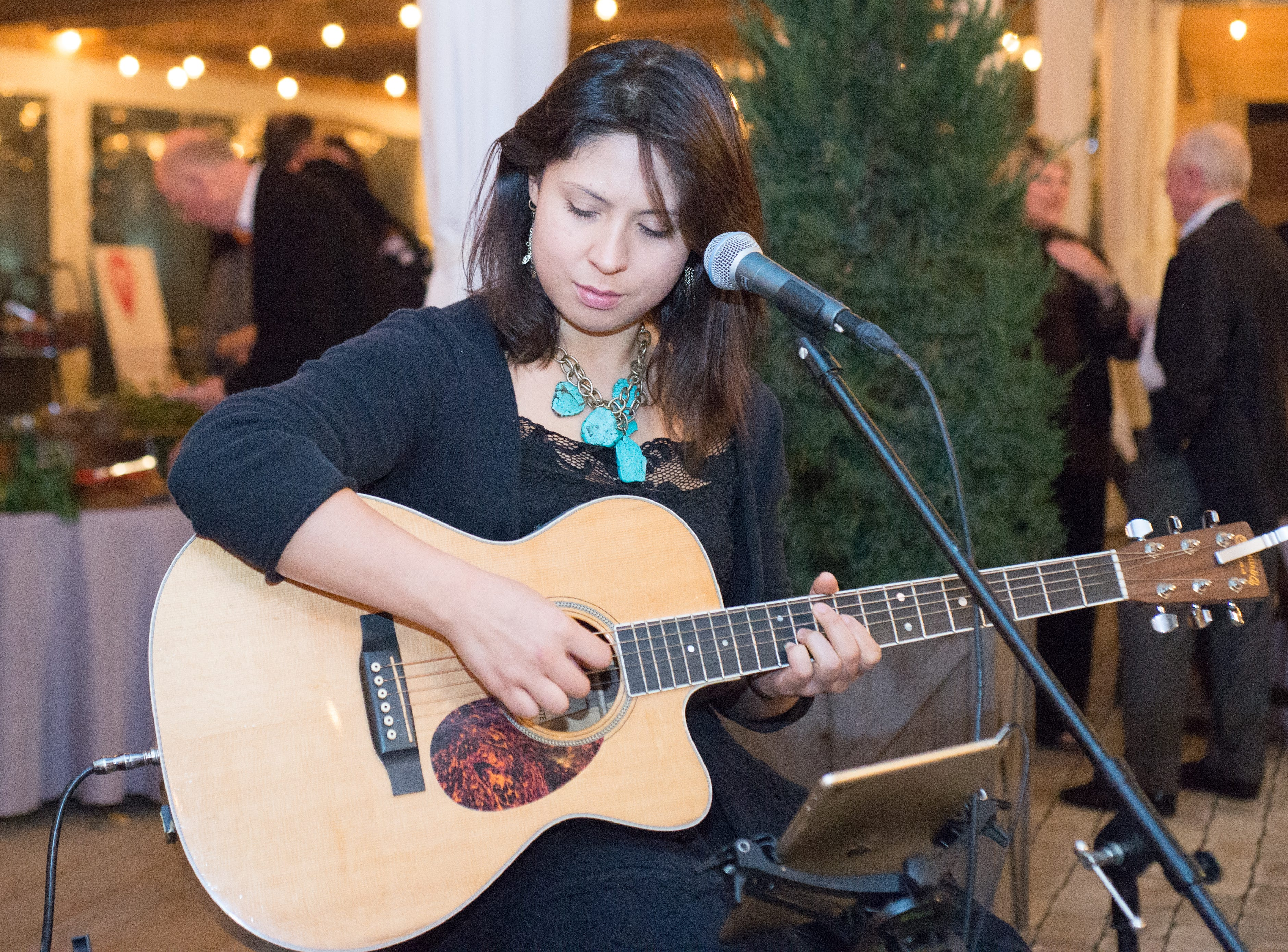 Kira Hooks adds some music to United Way of Sumner County's Bloomin' Bash Gala and Auction at Long Hollow Gardens in Gallatin on Friday, March 1.