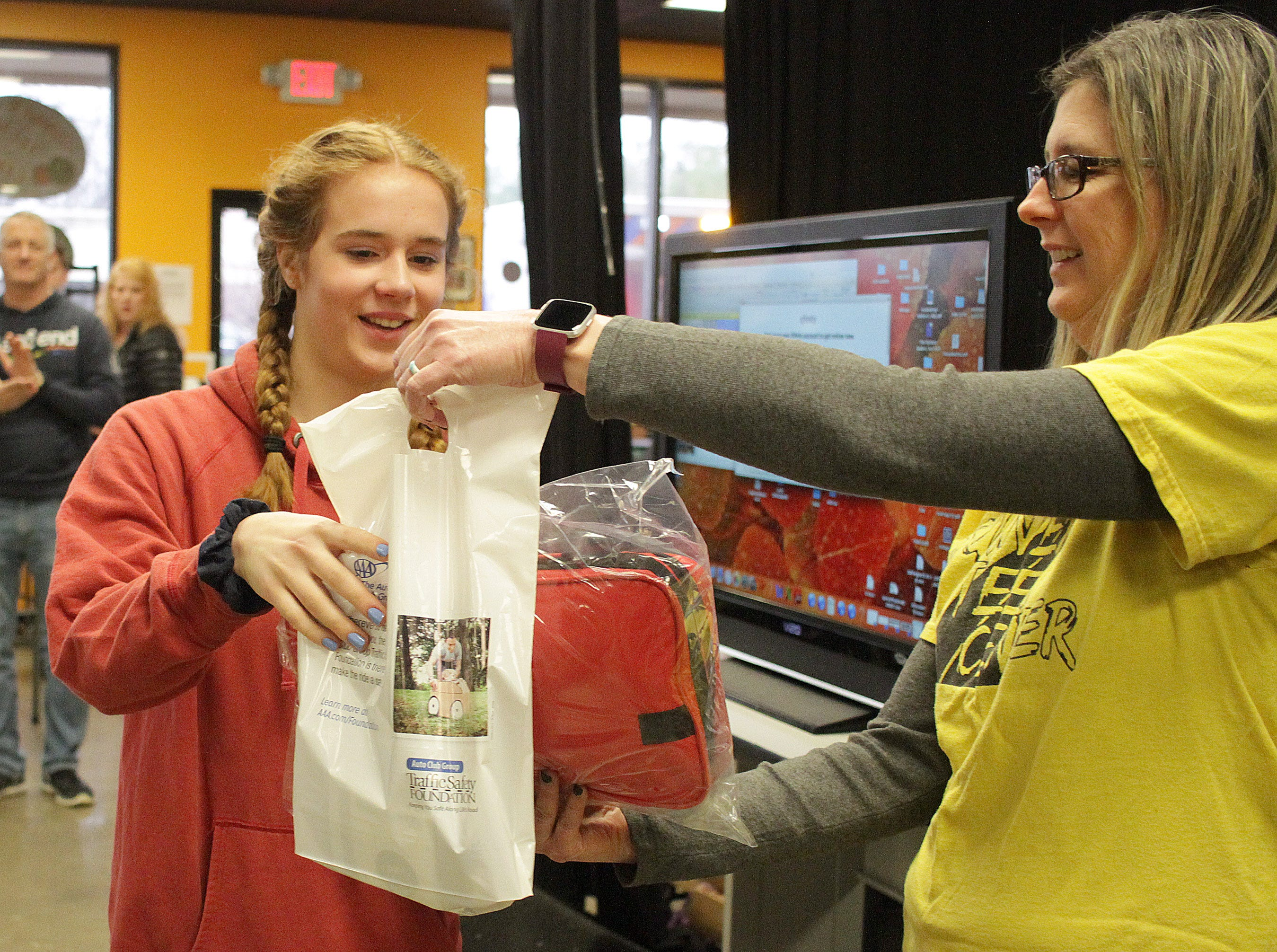 Kyra Siciliano wins a prize at Teen Driver Safety Day from Stacy Douglas (Program Director, Gallatin Teen Center) on Saturday, March 2, 2019.