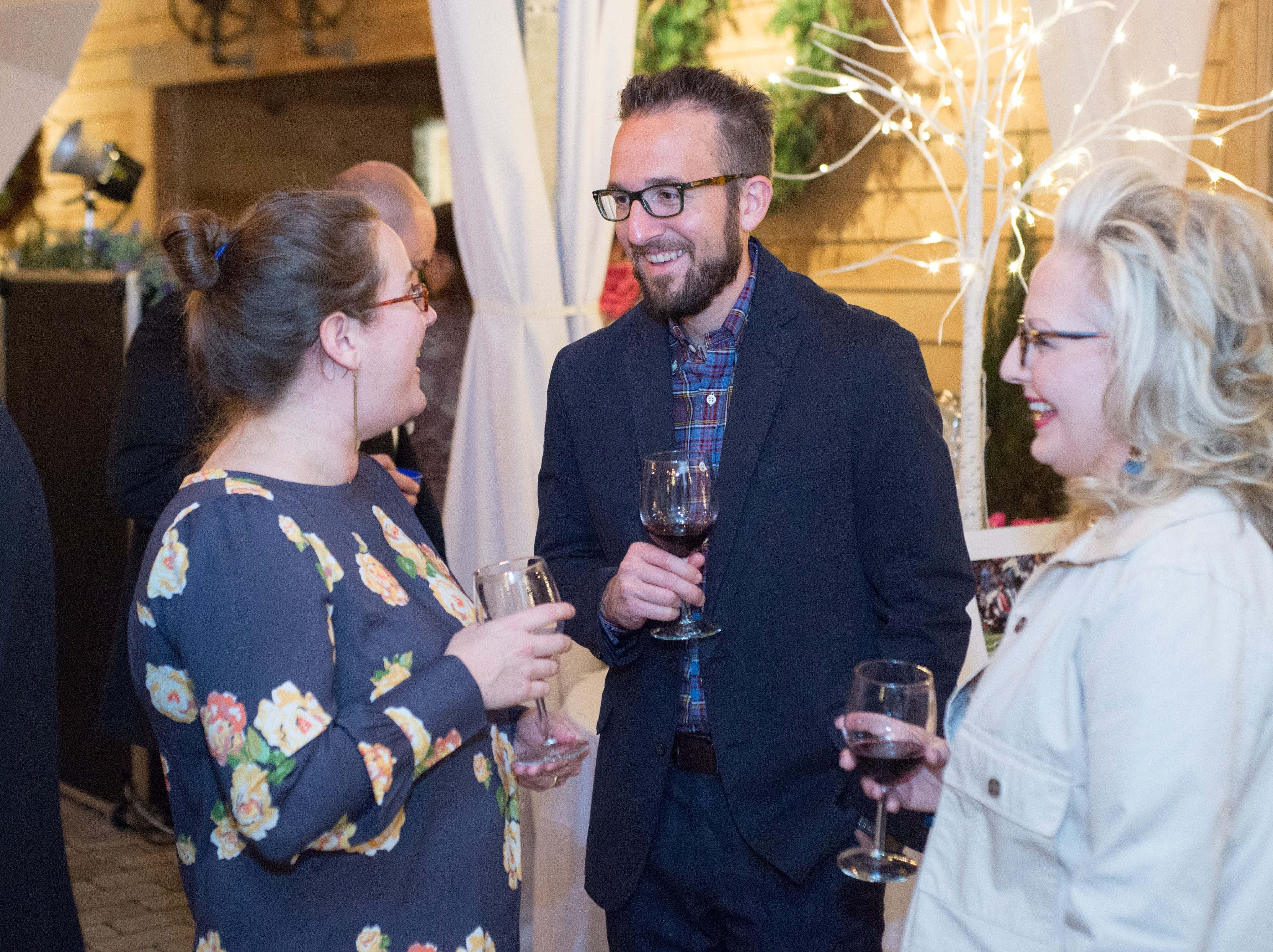 Anne and Jeremy Pade chat with Teri Long during United Way of Sumner County's Bloomin' Bash Gala and Auction at Long Hollow Gardens in Gallatin on Friday, March 1.
