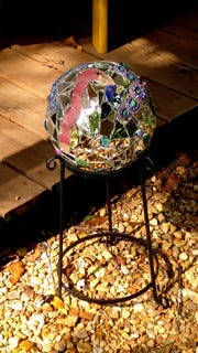 Janet Lovell of Gallatin made a mosaic gazing ball out of a bowling ball for her porch area.