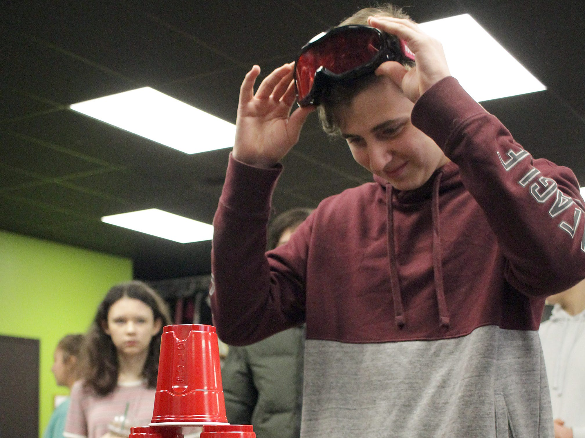 Colton Rutter takes a look at the cups he stacked in a depth perception exercise at the 4th Annual Teen Driver Safety Day in Gallatin , TN on Saturday, March 2, 2019.