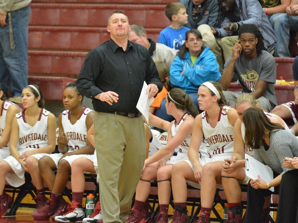 Then-Riverdale girls basketball coach Cory Barrett watches on during the Lady Warrriors 82-62 win over Smyrna on Monday night to open District 7-AAA play in 2013.