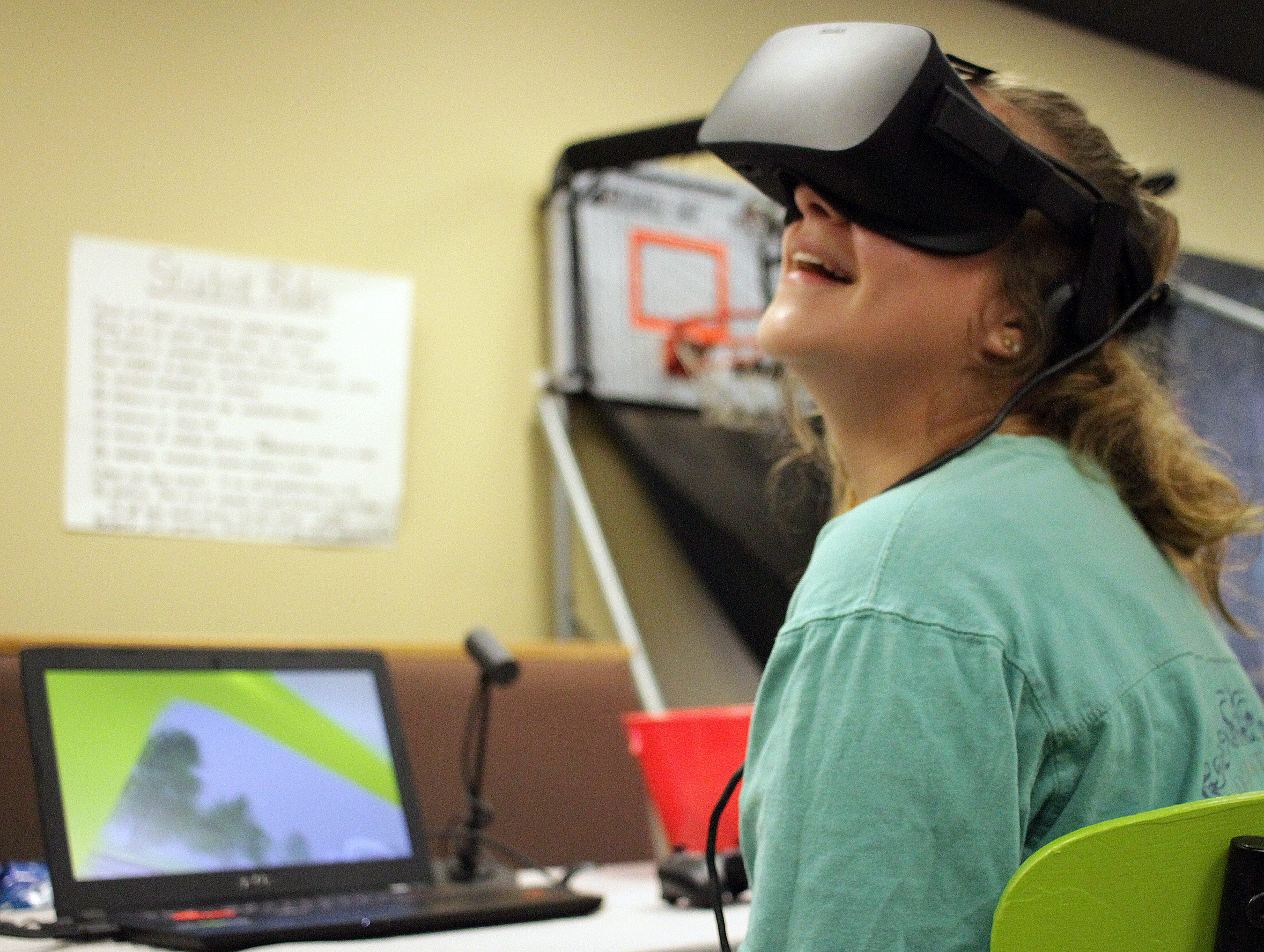 Emma Sanders uses virtual reality goggles for a truckers view at the wheel showing blind spots at the 4th Annual Teen Driver Safety Day in Gallatin, Tn on Saturday, March 2, 2019.